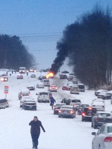 A car catches fire in Raleigh, North Carolina as drivers battle heavy snow on Wednesday, February 12, 2014.